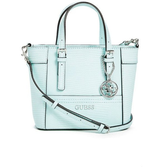 e05128371eba Guess Handbags - Guess mint purse and wallet